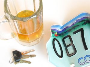Drunk driving concept, beer mug, keys, license plate