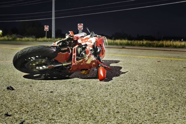 Motorcycle in road after accident