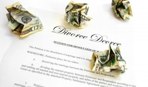 a divorce decree petition and cash laying on a table