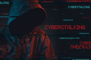 Cyberstalking theme with faceless man who's hooded with a digital glitch effect