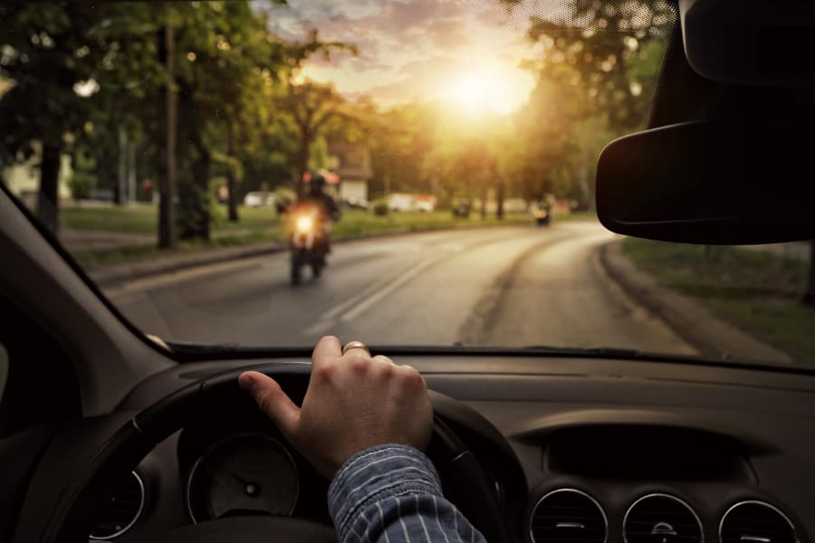 Driver looking ahead and motorcyclist on road