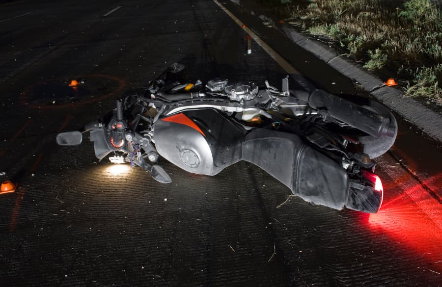 motorcycle on street at night after accident